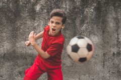 Skilled boy playing football Royalty Free Stock Images