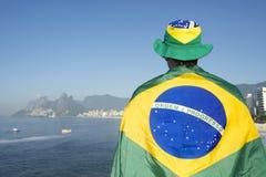 Brazilian Football Player wearing Flag at the Sea Stock Photo