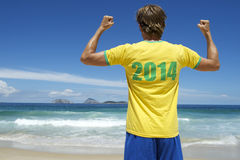 Brazilian in 2014 Football Shirt Celebrating on Rio Beach Royalty Free Stock Images
