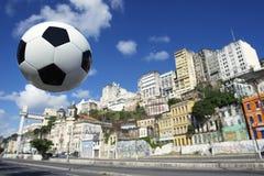 Brazilian Football Soccer Ball Salvador Bahia Brazil Skyline. Brazilian football soccer ball flying in the sky above Salvador Bahia Brazil city skyline stock photo