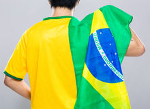 Brazilian football supporter hold with Brazil flag Stock Photos