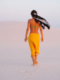 Brazilian girl. Girl walking in the dunes - National Park of Lencois Maranhenses - North of Brazil Stock Photos