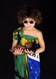 Brazilian girl holding doll Royalty Free Stock Photography