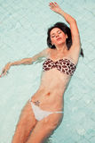 Brazilian Girl swiming in the pool. Woman swiming in the pool, natural Royalty Free Stock Images