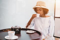 Brazilian girl with vintage cam in cafe drinking coffee stock photos