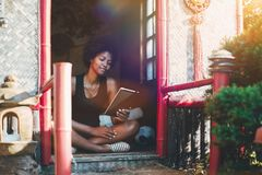 Brazilian Girl With Digital Pad In Pagoda Royalty Free Stock Photos