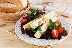 Brazilian grilled cheese snack queijo coalho, tomatos, bread Stock Photos