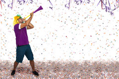 Brazilian guy blowing a horn at Carnival Stock Image