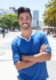 Brazilian guy with crossed arms at Avenida Atlantica at Rio de Janeiro Royalty Free Stock Photos