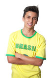 Brazilian guy with crossed arms in a yellow jersey Stock Images
