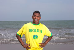 Brazilian guy standing at beach Royalty Free Stock Photography