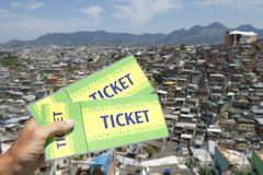 Brazilian Hand Holding Two Brazil Tickets Rio Favela Stock Image