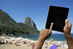 Brazilian Hands Using Tablet at Sugarloaf Rio de Janeiro Brazil Stock Images