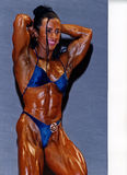 Brazilian Hardbody. Monica Martin of Brazil displays a top-flight physique of a professional woman bodybuilder.  She is massive yet defined and her scupted Stock Photography