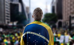 Brazilian holding the flag of Brazil in Paulista Avenue Stock Photos
