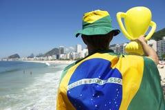 Brazilian Holding Trophy Rio de Janeiro Skyline royalty free stock image