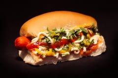 Brazilian hot dog, black background. Brazilian hot dog in black background, fast food from Brazil Stock Image