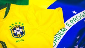 Brazilian jersey and flag in front of view stock images