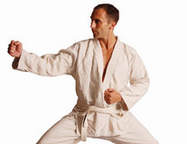 Brazilian Jiu jitsu Gi. Tan White male in brazilian jiu-jitsu gi kimono robe Royalty Free Stock Photography