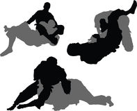 Brazilian Jiujitsu - Sumbissions 01. Silhouettes of grapplers engaged in a the practice of Brazilian Jiujitsu. These images demonstrate three different Stock Images