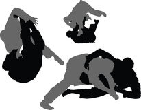 Brazilian Jiujitsu - Sweeps 01. Silhouettes of grapplers engaged in a the practice of Brazilian Jiujitsu. These images demonstrate three different techniques Royalty Free Stock Images