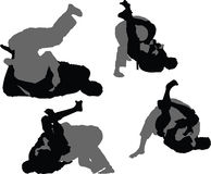 Brazilian Jiujitsu - Triangle Choke. Silhouettes of two grapplers engaged in a match during a Brazilian Jiujitsu tournament. These images show the progression of Stock Photography