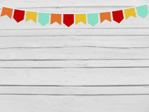 Brazilian june party, festa junina mockup. Birthday or baby shower mockup scene. Party paper flags. Wooden background. Stock Photo