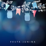 Brazilian June party, festa junina. String of lights, mason jar lanterns and paper flags. Midsummer garland of leaves Stock Photos