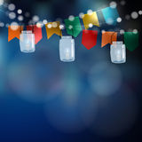 Brazilian june party. Festa junina. String of lights, party flags. Jar lanterns. Summer garden party decoration. Festive blurred background. Stock  invitation Stock Photo