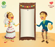 Brazilian June Party happy hick couple holding blank thematic bo. Made in Brazil - Made with love - High quality detailed vector cartoon for june party themes Royalty Free Stock Image