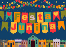 Brazilian the June Festival. Latin American holiday, the June party of Brazil, bright night the background with colonial houses, church, lights and colored flags Stock Images