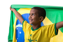 Brazilian little boy fan holding the flag of Brazil Royalty Free Stock Images