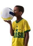 Brazilian little boy fan holding volleyball ball Stock Images
