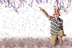 Brazilian Man at Carnival. Brazilian man pointing, Carnival confetti and serpentine background Stock Photo