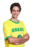 Brazilian man with crossed arms and short black hair Royalty Free Stock Photos