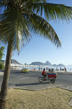 Brazilian Man Delivering Beach Chairs Copacabana. RIO DE JANEIRO, BRAZIL - FEBRUARY 03, 2014: Brazilian man delivering cooler and chairs to beach kiosk on a royalty free stock images