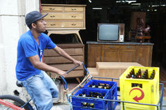 Brazilian Man Delivering Beer on Bicycle Stock Photography