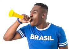 Brazilian man fan celebrating on footbal match on white background. Brazil colors. Man wearing generic brandless generic blue stock image