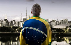 Brazilian man holding the flag of Brazil in Sao Paulo Stock Image