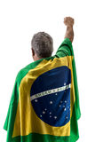 Brazilian man holding the flag of Brazil on white background Royalty Free Stock Photography