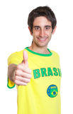 Brazilian man with short black hair showing fist. On an isolated white background for cut out Stock Photography