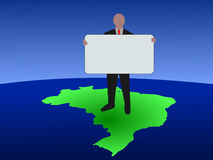 Brazilian man with sign on map Royalty Free Stock Images