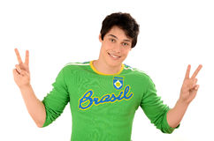 Brazilian man signing victory for Brazil. Stock Photos