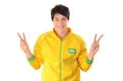 Brazilian man signing victory for Brazil. Royalty Free Stock Photos