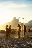 Brazilian Men Showering at Sunset Ipanema Rio Royalty Free Stock Photography