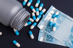 Brazilian money and pills Stock Photography