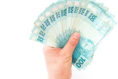 Brazilian money, reais, high denominations held in the palm of your hand. Brazil money, reais, high denominations held in the palm of your hand stock image