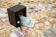 Brazilian money saved. Reais (Real), Brazilian money background and safe Royalty Free Stock Photo