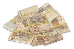 Brazilian money tied and piled. stock image