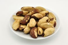 Brazilian nuts on plate Stock Photography